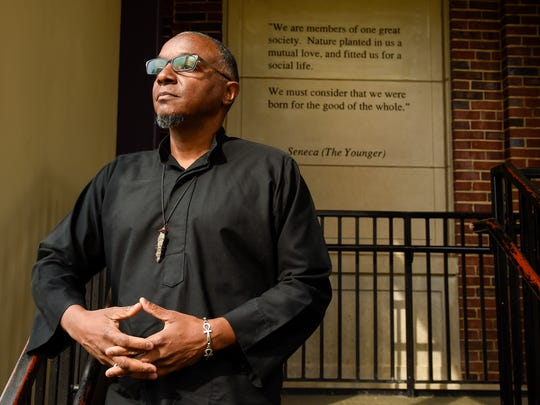 Activist and preacher jeff obafemi carr looks outside