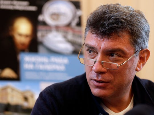 Opposition leader Boris Nemtsov speaks as he presents his new book about the wealth of Vladimir Putin at a news conference in Moscow on Aug. 28, 2012. Nemtsov was assassinated in 2015.