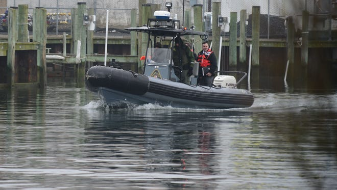A Maryland Natural Resource Police exits a harbor in West Ocean City out toward the Atlantic Ocean where a plane has gone missing off the coast of Assateague on Thursday, March 1, 2018.