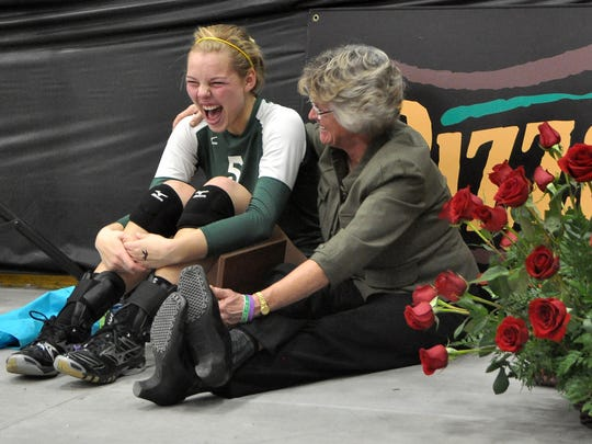 West High senior Hannah Infelt, left, shares a laugh with volleyball coach Kathy Bresnahan following their Class 4A state championship victory over City High on Saturday, Nov. 12, 2011, at the Cedar Rapids Ice Arena. West High won the match in five sets.