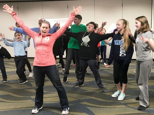 Director Kristin Laufersweiler leads the Shrek cast in a recent rehearsal. The group has been rehearsing since January.