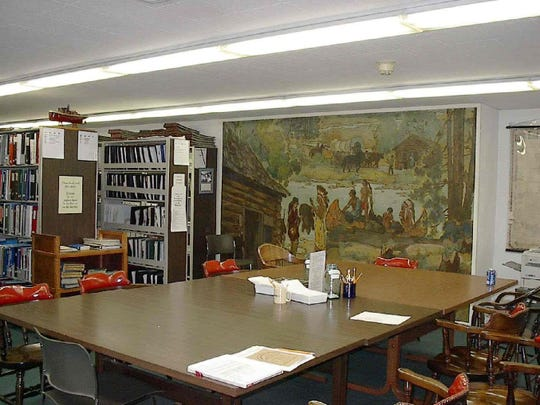 The Sheboygan County Historical Research Center library showcasing a mural which once hung in Judge Schlichting's courtroom in the Sheboygan County Courthouse.