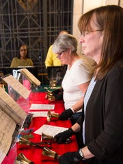 The St. Francis Catholic Church handbell choir practices in the choir loft. The handbell choir began 25 years ago with a $5,000 donation from church member Dave Rodgers.