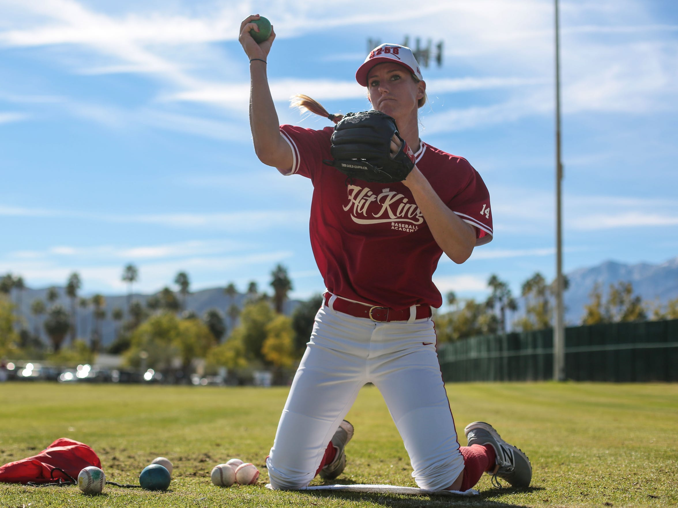 Katie Griffith, the only woman playing in the California Winter League warms up for practice with her team, the Hit King Tuesday, January 31, 2017 in Palm Springs. She is a pitcher with the team.