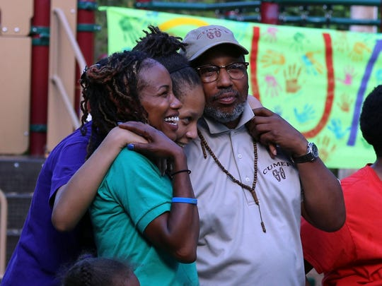 Nia Nunn-Makepeace, left, and her father, Fé Nunn, share a moment at the 12th annual Community Unity Music Education Program concert Thursday at the Southside Community Center.