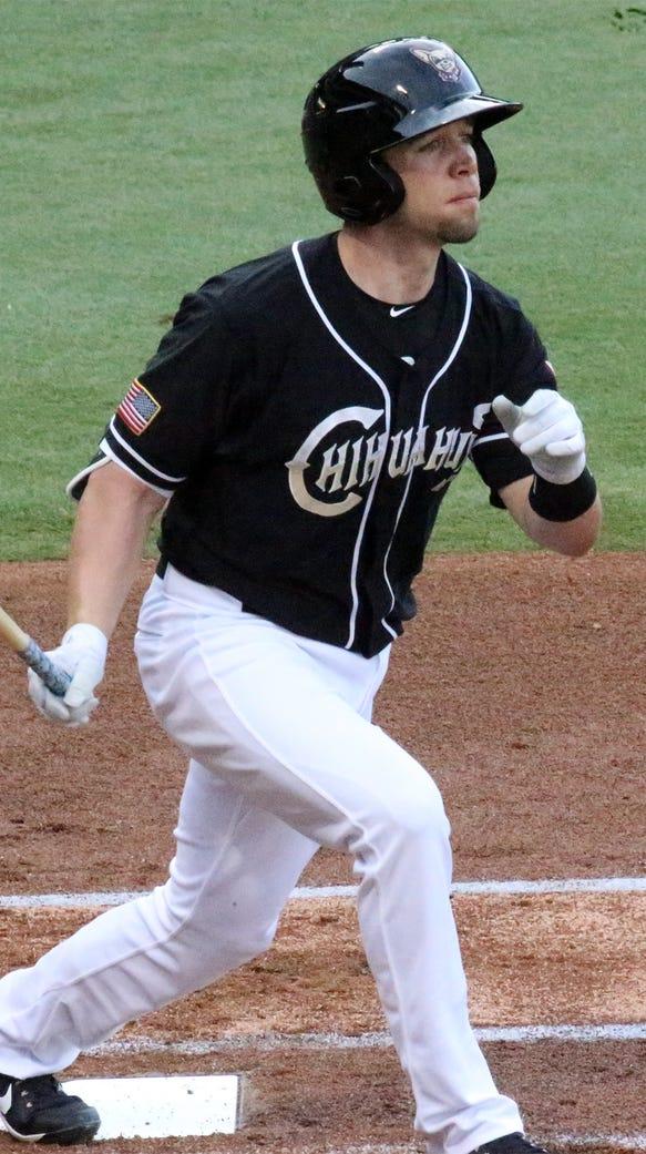El Paso Chihuahuas designated hitter Ryan Schimpf hits