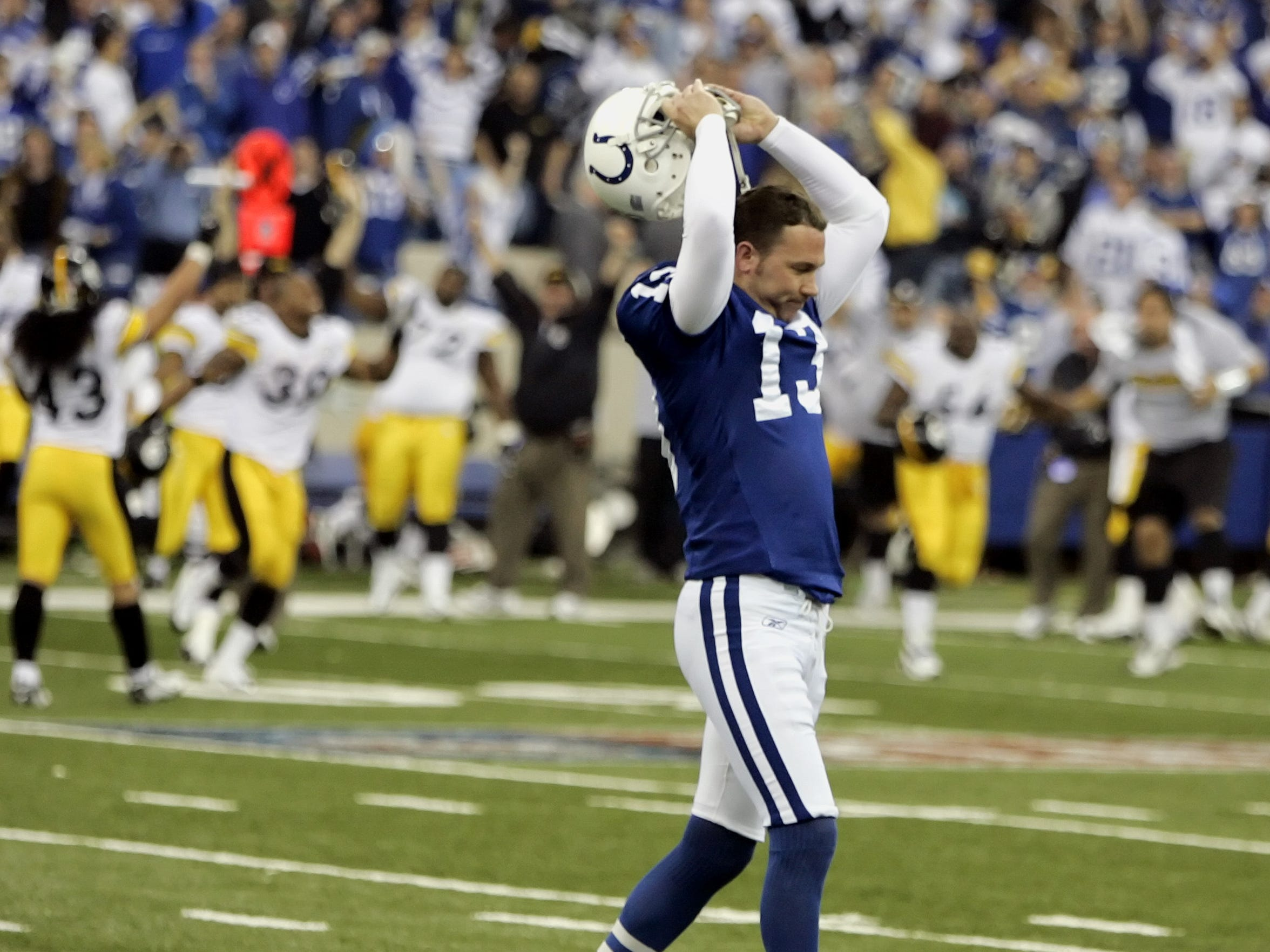 """""""He overcooked it,"""" Bill Polian says of Mike Vanderjagt's missed 46-yard field goal attempt in the waning moments. It'd be Vanderjagt's last as a Colt."""