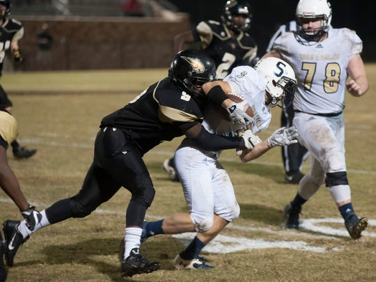 Sycamore's Mack Waddell runs the football