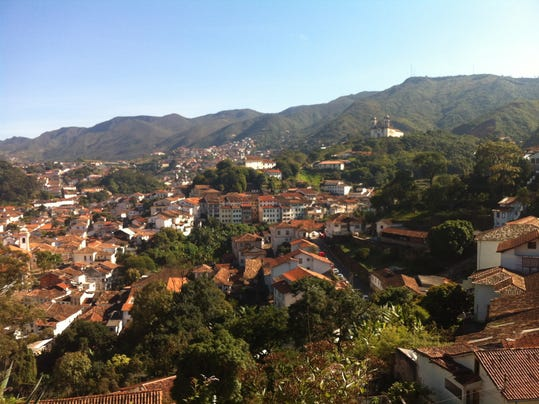 """This June, 25, 2014, photo, shows a birds eye view of the town of Ouro Preto Brazil. Removed from the bustling World Cup host city of Belo Horizonte, Ouro Preto is the charming colonial town that gave birth to Brazil's independence. A UNESCO world heritage site whose name means """"Black Gold,"""" is a former mining village whose tremendous wealth made it a cultural focal point of the era. (AP Photo/Frank Griffiths)"""