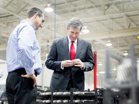 Gov. Roy Cooper checks out a planet gear while touring