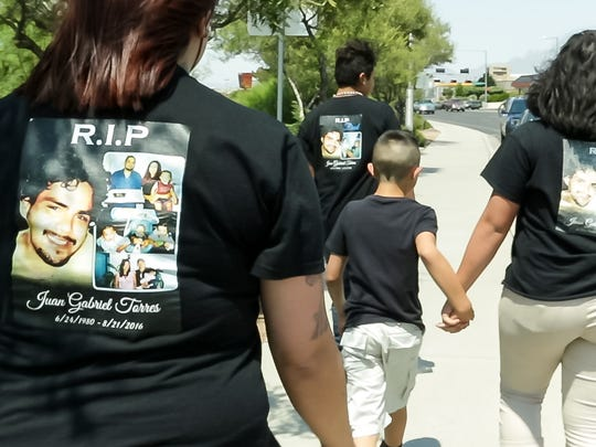 Maggie Calderon, Juan Gabriel Torres' ex-girlfriend, and their children -- Juan Gabriel Torres Jr.,  Breeana Torres and Jerry Torres -- wear black t-shirts in his memory.