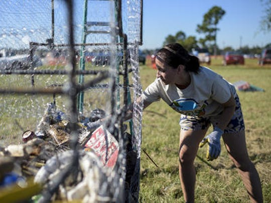 A resident collects litter during roundup in October.