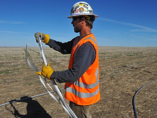 Marshall Cripps of Outback Power Company prepares a