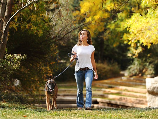 Michelle Rosario with her Belgian Malinios dog Letti at Parley's Historic Nature Park in Salt Lake City Saturday, Oct. 17, 2015.