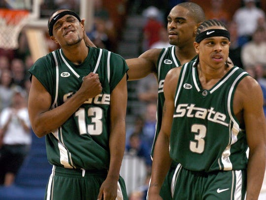 Maurice Ager (13), Alan Anderson and Shannon Brown (3) celebrate after MSU's double-overtime win over Kentucky on March 27, 2005 that sent the Spartans to their fourth Final Four in seven years under Tom Izzo.