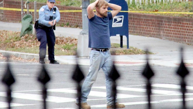 In this Dec. 4, 2016, file photo, Edgar Maddison Welch, 28 of Salisbury, N.C., surrenders to police in Washington. Welch, who said he was investigating a conspiracy theory about Hillary Clinton running a child sex ring out of a pizza place, fired an assault rifle inside the restaurant on Sunday injuring no one, police and news reports said. Fake news, social media bots, a post-fact world. One of the great lessons of the 2016 U.S. presidential campaign is that people could not _ or would not _ distinguish between actual news stories and fabrications.