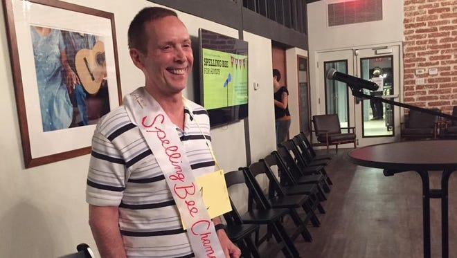 Michael Petrina is all smiles at the AAJA Arizona Spelling Bee for Adults.