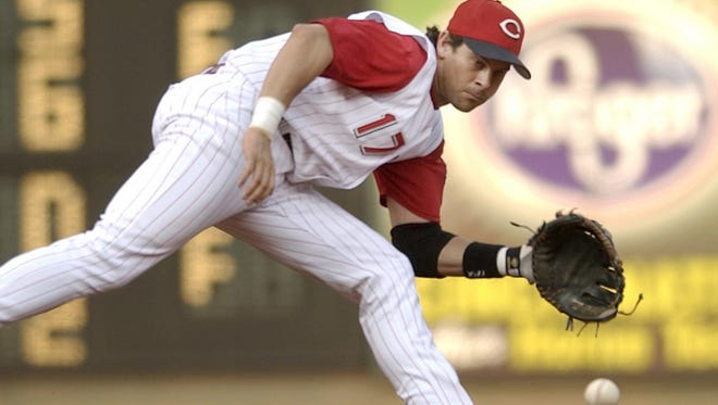 The Reds' Aaron Boone fields a ball in July of 2003.