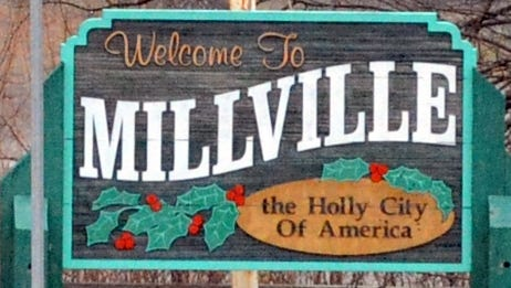 Welcome to Millville sign for carousel.  Staff photo/Charles J. Olson