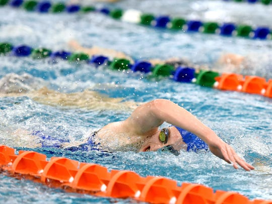 Corinne Pelzer swims laps during practice for the Sioux