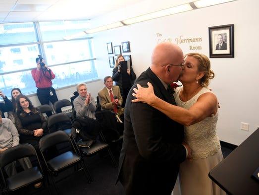 Todd and Ada Cochran of Mahwah kiss as newly weds at