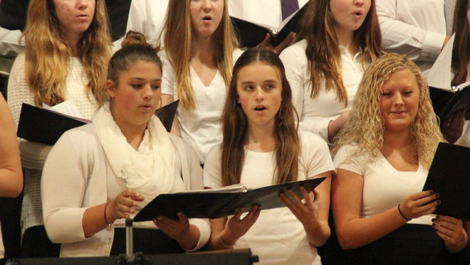 Members of the Williamsburg High School choirs perform their annual concert at the 2014 Grand Concert. This year's concert, the first to be presented in the high school's new gymnasium, is Sunday, Dec. 11.