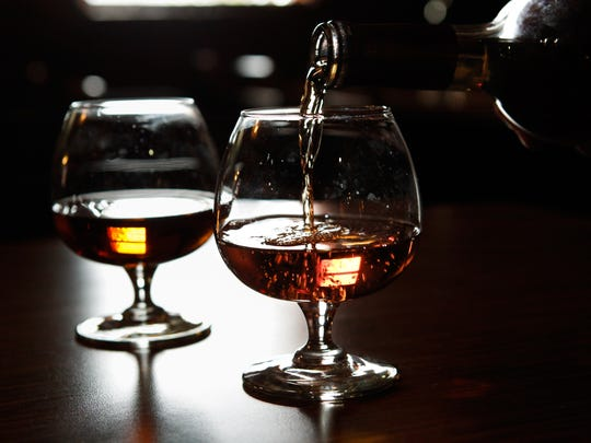 A glass of Valley Vineyards' barrel-aged Honey Mead is poured into a glass Thursday Feb. 18, 2016.