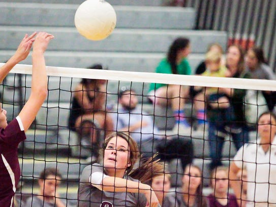 Eagleville's Taylor Reed (8) hits a ball over during