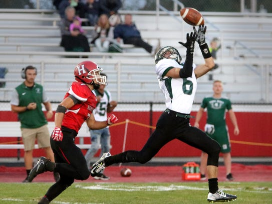 Wauwatosa West's Spencer Whitlock eludes Sussex Hamilton's