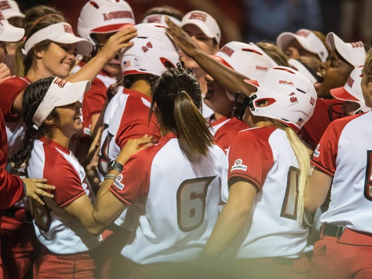 UL outfielder Beth Ashley (29) celebrates with her
