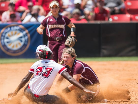 UL's Kalyn Watts slides safety into third base during the 2018 Sun Belt Conference Tournament championship game Saturday at Lamson Park.