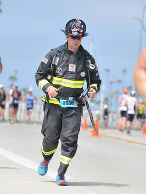 Rob Verhelst, a Madison firefighter, runs in his full gear to honor 9/11 victims.