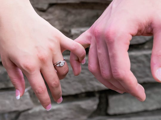 Tori Bates shows off her engagement ring after Bobby Smith proposed to her in North Carolina.