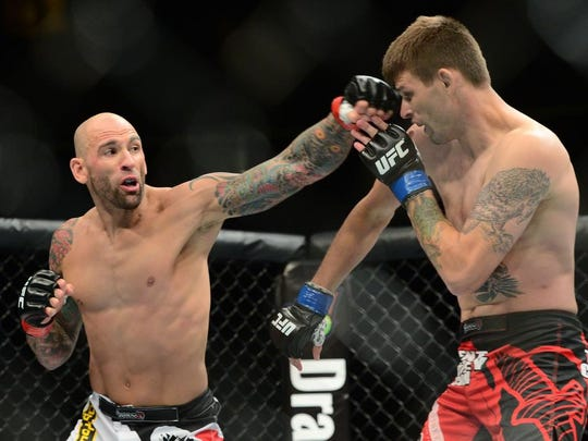 George Sullivan (left) strikes Tim Means during a UFC card at the Prudential Center in Newark.
