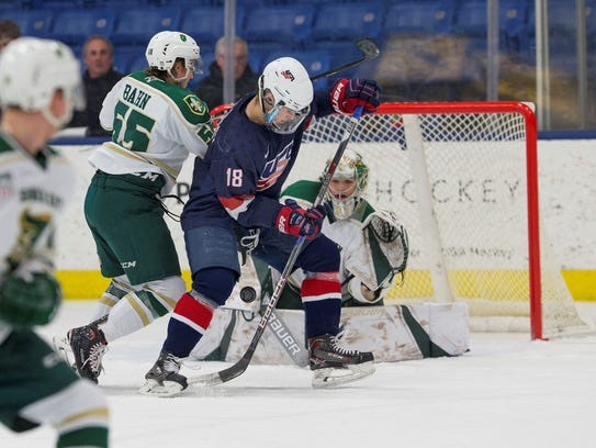Battling in front of Sioux City goalie Ben Kraws are