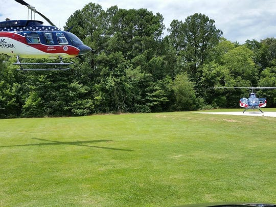 Two Air Evac Lifeteam helicopters make an appearance at the unveiling of the new helipad.
