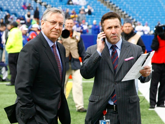 ORCHARD PARK, NY - OCTOBER 19:  Buffalo Bills owner Terry Pegula (L) and President and Chief Executive Officer Russ Brandon stand on the sidelines before the game between the Buffalo Bills and the Minnesota Vikings at Ralph Wilson Stadium on October 19, 2014 in Orchard Park, New York.  (Photo by Michael Adamucci/Getty Images)
