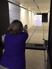 Jessica Keffer, founder of the Lancaster chapter of The Well-Armed Woman, practices shooting her firearm.