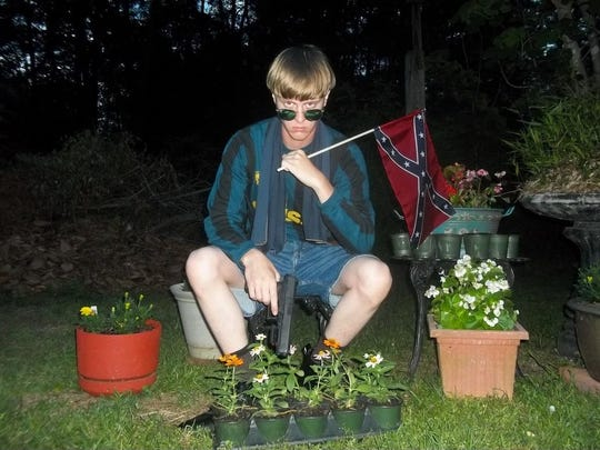 "A photo from ""The Last Rhodesian"" website appears to show Dylann Roof with a gun. Evil, not flags, caused Roof to shoot parishioners in a South Carolina church, argues Orrin Johnson."