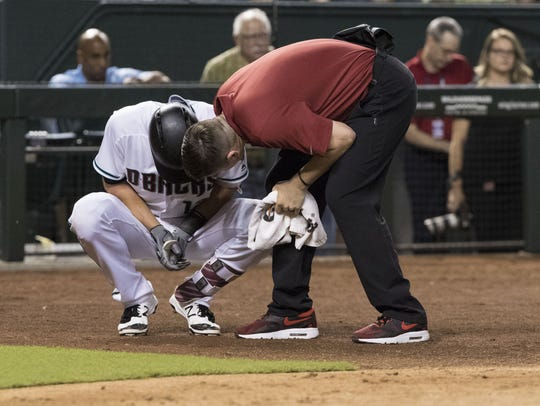 Diamondbacks shortstop Nick Ahmed reacts to breaking
