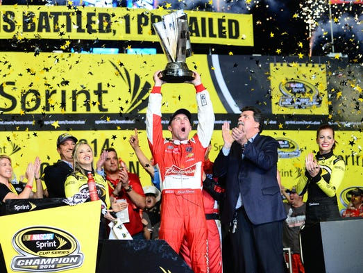 Race 10: Kevin Harvick hoists the Sprint Cup championship
