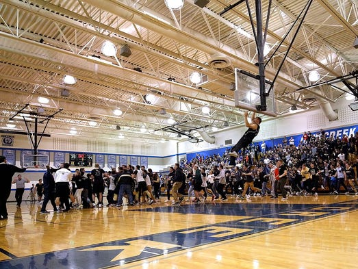 Franklin fans take to the court and hang from the rim