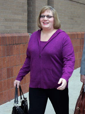 "FILE - In this Nov. 12, 2012, file photo, Susan ""Liz"" Van Note walks outside the Clay County Courthouse in Liberty, Mo. Van Note, a suburban Kansas City attorney, was acquitted Tuesday night, Feb. 14, 2017, of two counts of first-degree murder in the 2010 deaths of her father, William Van Note and his girlfriend, Sharon Dickson. (Jim Barcus/The Kansas City Star via AP, File)"