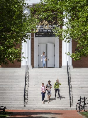 Students walk through the University of Delaware's campus in Newark in this file photo.