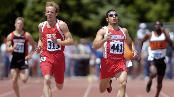 Sioux Falls Lincoln's Sayfe Jassim (441) and Rapid City Central's Cole Tucker (313) run neck-and-neck at Howard Wood Field during the 2005 state track meet. Jassim earlier that season won the special event.