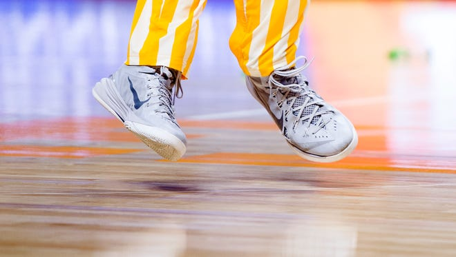 A player warms up during an NCAA SEC-Big 12 basketball game between Tennessee and Kansas State at Thompson-Boling Arena in Knoxville, Tennessee on Saturday, January 28, 2017.