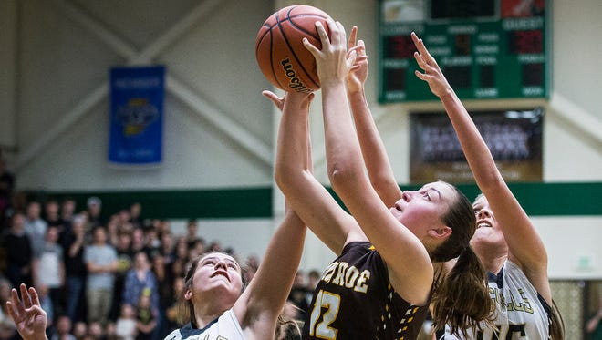 Monroe Central's Jordyn Barga fights for a shot past Madison-Grant's defense during their game at Eastern High School in Greentown Saturday, Feb. 11, 2017.