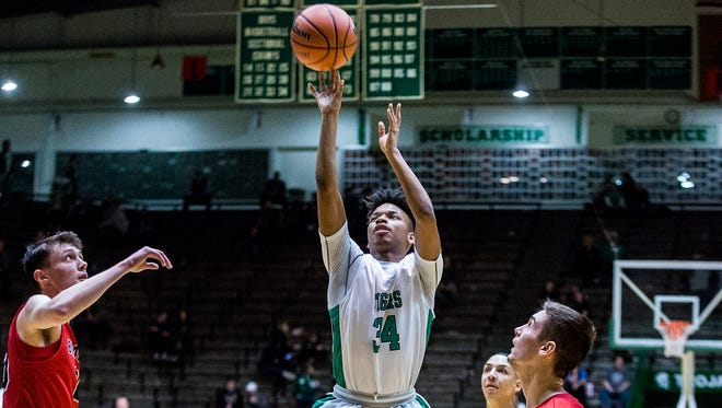 Yorktown's Milon McCowan shoots against Blackford during their sectional game at New Castle High School Tuesday, Feb. 27, 2018.