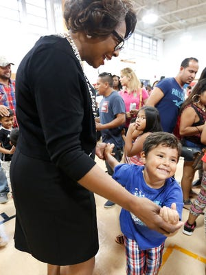 East Ramapo School District superintendent Dr. Deborah Wortham, celebrates with Cesar Vasdonez after his name was called during the full-day kingergarten lottery at East Ramapo Central School District administration building in Spring Valley on Thursday, September 01, 2016.