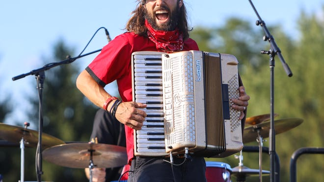 The Chardon Polka Band's Jake Kouwe rocks the accordion during the City of Aurora's 2020 Drive-Up Concert Series at Hartman Park and Athletic Fields.